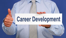Career Development - Manager with sign and thumb up. Career Development - Manager holding sign with text and thumb up royalty free stock images