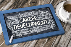 Career development with related word cloud hand drawing on black Stock Images