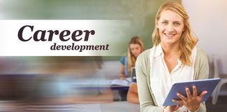 Composite image of career development word. Career development word against female teacher using digital tablet in class Stock Photography