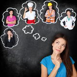Career education - student thinking of future. Career education choice options - student thinking of future education. Young Asian woman contemplating career Royalty Free Stock Image