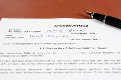 Career in Germany. Business objects - full time employment contract in German language ready to sign with ink pen. Germany career. Fictitious generic company Royalty Free Stock Photos