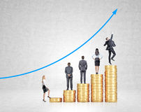 Career growth in business. Five heaps of golden coins arranged as a bar chart, four businessmen on them, businesswoman starting to assend. Blue graph at the Stock Photos