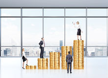Career growth. Businesswoman with loudspeaker on top bar, three businesspersons listening. Coins arranged in bar chart. Paris panoraimic view at background Royalty Free Stock Image