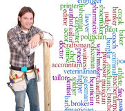 Career guy. One young caucasian guy with construction tools and gear beside a list of career choice words Stock Image