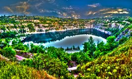 Career in Krivoy Rog in Ukraine. Panoramic landscape - a flooded quarry in the city of Krivoy Rog in Ukraine stock photo