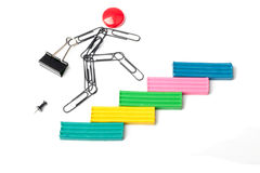 Career ladder. The person from paper clips runs on a plasticine ladder Stock Photo