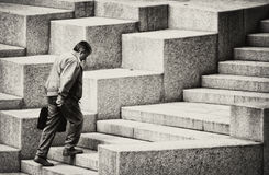Career. Moscow, Russia, June 1, 2012. Man with briefcase up the stairs Stock Photo