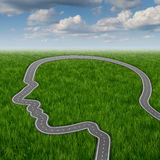 Career Path. And business planning decisions through education and searching for financial opportunities as a road or highway in the shape of a human head on a Royalty Free Stock Images