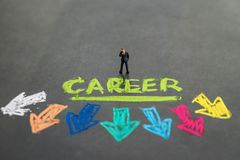Career path and work opportunities concept by small miniature pe. Ople businessman standing and thinking on colorful handwriting chalk the word CAREER with multi Stock Photos