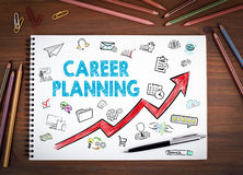 Career Planning Business Concept. Notebooks, pen and colored pencils on a wooden table stock illustration