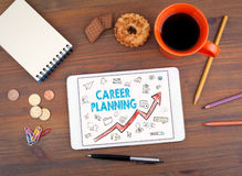 Career Planning Business Concept. Tablet on an old wooden table Royalty Free Stock Photos