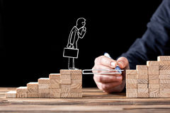 Career Planning Concept. Businessman Getting Help Building Bridg. Es To Success stock photo