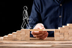 Career Planning Concept. Businessman Getting Help Building Bridg Stock Photography