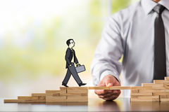 Career Planning Concept. Businessman Getting Help Building Bridg. Es To Success Royalty Free Stock Photo