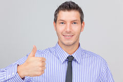Career positive business. Smiling expressing positive businessman with tie and thumb Royalty Free Stock Photography