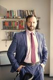 Career, profession, work. Businessman or director pose at workplace. Business, entrepreneurship concept. Fashion, style, dress code. Man with beard in blue royalty free stock images