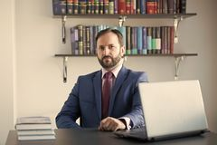 Career, profession, work. Man in blue formal suit at office workplace. Business, entrepreneurship concept. Computer, technology, information. Businessman with stock photo