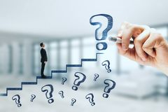 Career promotion and doubt concept. Businessman climbing abstract stairs sketch with question marks on blurry background. Career promotion and doubt concept stock image