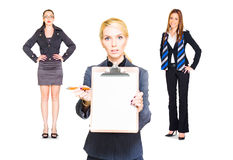 Career Recruitment Business Woman With Job Offer. Studio Portrait Of A Team Of Three Business People Offering A Copyspace Clipboard With Contract To Sign In A Stock Photography