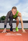 Career start. Conceptual image of an athlete (sprinter) ready to start a business career. Performane in business is top sport Stock Photo