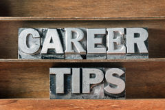 Career tips tray. Career tips phrase made from metallic letterpress type on wooden tray Royalty Free Stock Photography