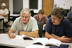 Career Training at Any Age. A man in his fifties going back to school for career training Stock Image