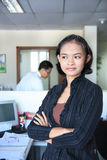 Career woman. Standing in office Royalty Free Stock Photos