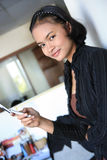 Career woman. Standing in office Stock Photo