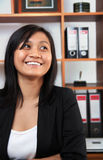 Career woman. Portrait of young asian career woman smileing in office Stock Photos