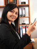 Career woman. Portrait of career woman posing in office Royalty Free Stock Photography