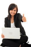 Career woman. With laptop thumb-up Royalty Free Stock Photos