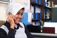 Career woman. Wearing muslim dress in the office Stock Image