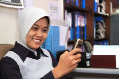 Career woman. Wearing muslim dress in the office Royalty Free Stock Images