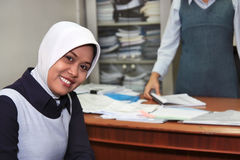 Career woman. Wearing muslim dress in the office Royalty Free Stock Photography