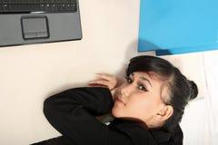 Career woman. Portrait of beautiful career woman holding laptop Royalty Free Stock Image