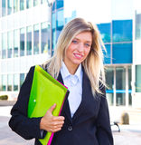 Career woman. Beautiful career woman in front of office Stock Image