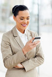 Career woman cell. Beautiful young career woman using cell phone Stock Images