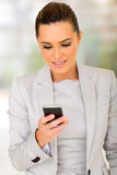 Career woman cell phone. Beautiful young career woman using cell phone Stock Photos