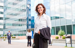 Career woman. A career woman hanging jacket and bag Royalty Free Stock Photography