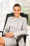 Career woman office. Beautiful young career woman sitting in office Stock Photo