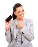 Career woman smart phone. Pretty career woman pointing at smart phone on white background Stock Image