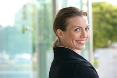Career woman smiling outside. Close up portrait of a friendly career woman smiling outside Stock Images