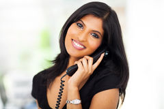 Career woman telephone. Beautiful career woman talking on telephone in office Stock Photo