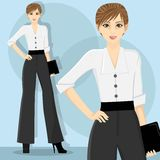Career Woman. Young and pretty career woman wearing white blouse Stock Photo