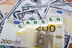 Career Word with Letters Among Banknotes. Career word with green letters among cash dollar, euro and turkish lira banknotes on wooden background Stock Images