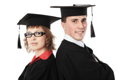 Careerists. Portrait of a young men in an academic gown. Educational theme royalty free stock photography