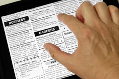 Careers. Fake Classified Ad, newspaper and Touch Screen, business concept Royalty Free Stock Photography