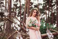 Carefree Adorable Bride With Bouquet In Nature Stock Image