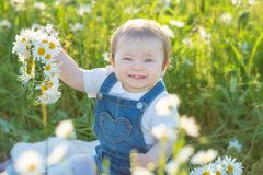 Carefree adorable girl with bouquet in fairy field of chamomile. Summer freedom enjoy concept royalty free stock photo