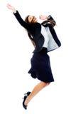 Carefree affärskvinnahopp royaltyfri fotografi